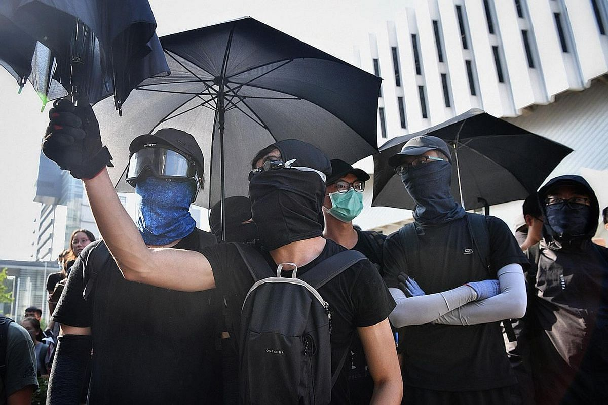 A protester using a fire extinguisher to slow down the police advance last month. Scenes of unprecedented violence have been broadcast constantly, sparking fears that this could normalise violence. Police firing tear gas at protesters from inside the