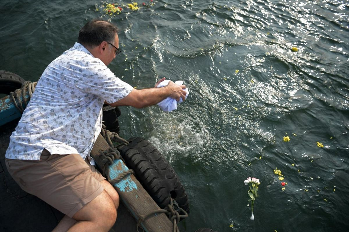 Mr Gino Hardial Singh scatters his late father's remains into the waters on Sept 7, 2019.