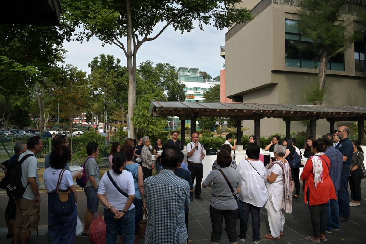 Associate Professor Ng Yee Kong (middle, holding mic), coordinator of the Silent Mentors Programme, thanking family members and friends of the silent mentors for the sacrifice before the sea burial at Changi Point Ferry Terminal on Aug 3, 2019.