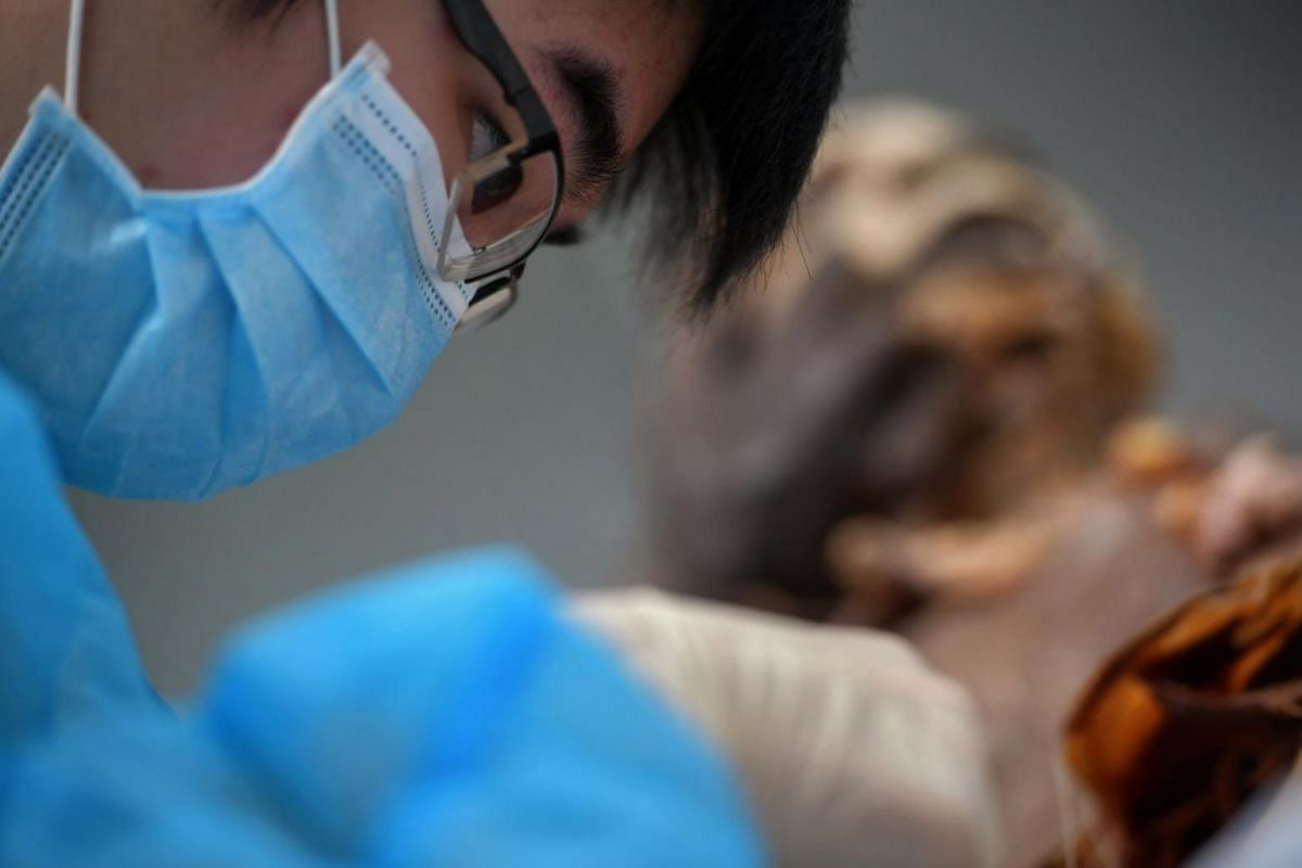 Wayne Ng, a second-year medical student from Nanyang Technological University's Lee Kong Chian School of Medicine, working on Mr Hardial Singh's body during a suturing class, on June 25, 2019. This year, some 300 students, including about 10 dentistr