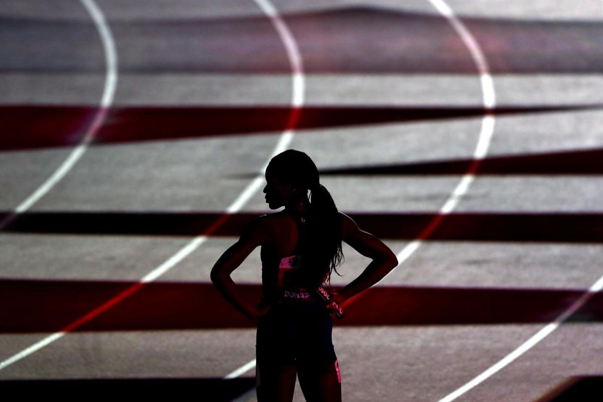 American Phyllis Francis stands at the start of the Women's 4x400m Relay Final, at Khalifa International Stadium in Doha, Qatar, on Oct 6, 2019.