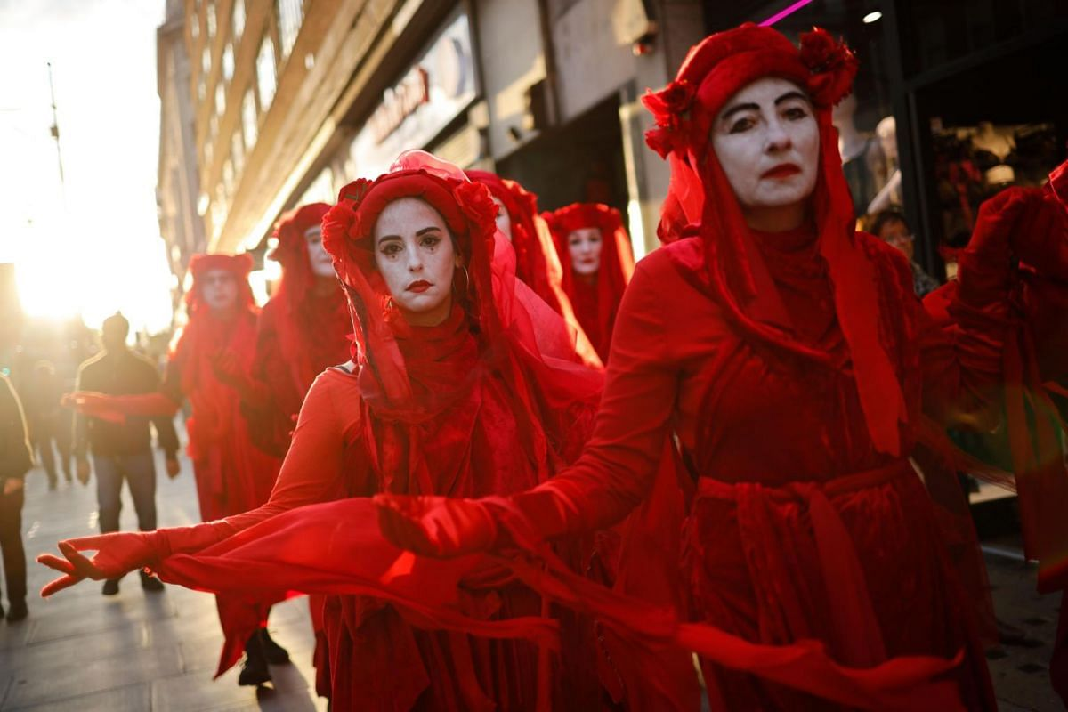 Protesters march down Oxford Street near Marble Arch in London at an opening ceremony to mark the beginning of the International Rebellion on Oct 6, 2019, an event organised by Extinction Rebellion.