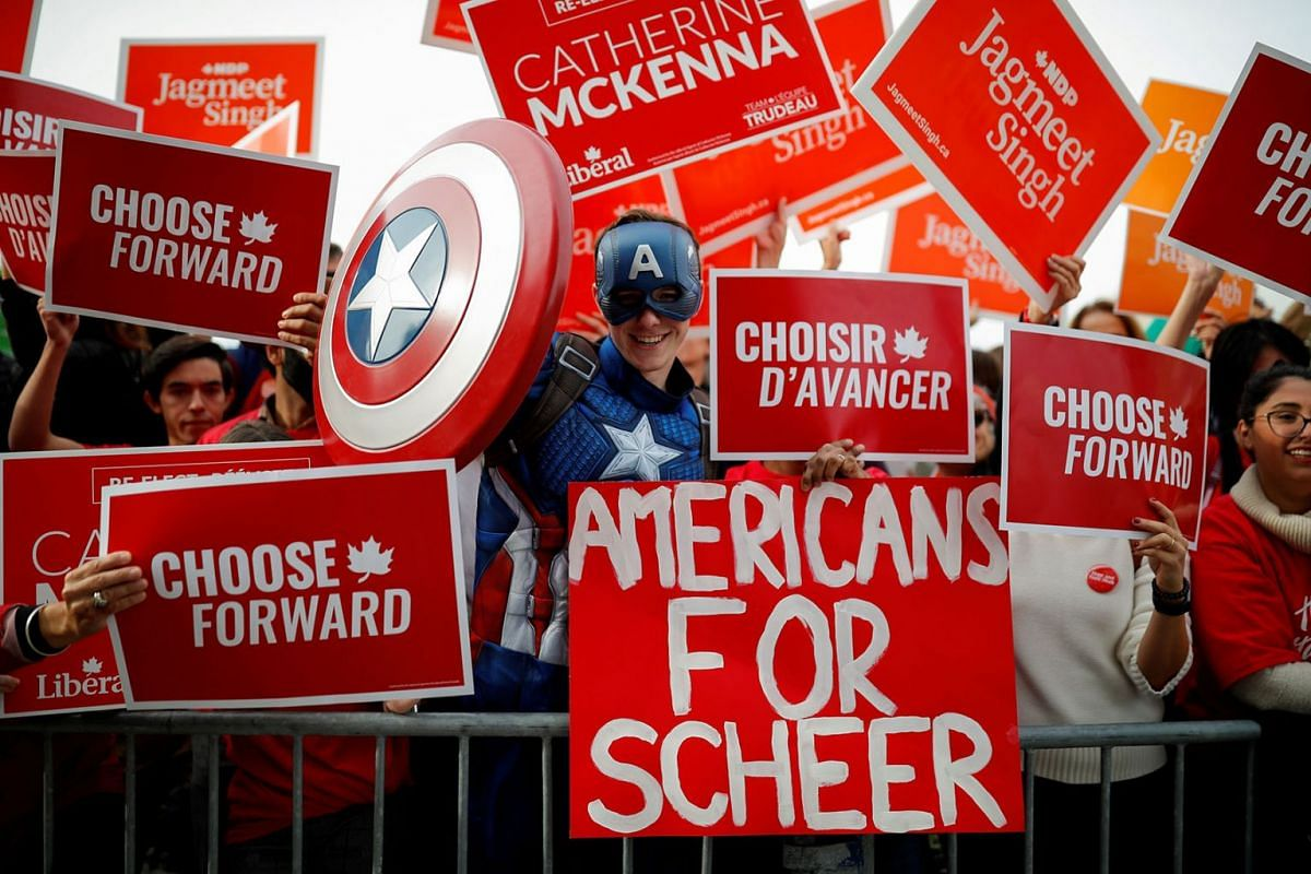 A person dressed up as Captain America holds a placard as supporters gather before an English language federal election debate at the Canadian Museum of History in Gatineau, Quebec, Canada, Oct 7, 2019. PHOTO: REUTERS