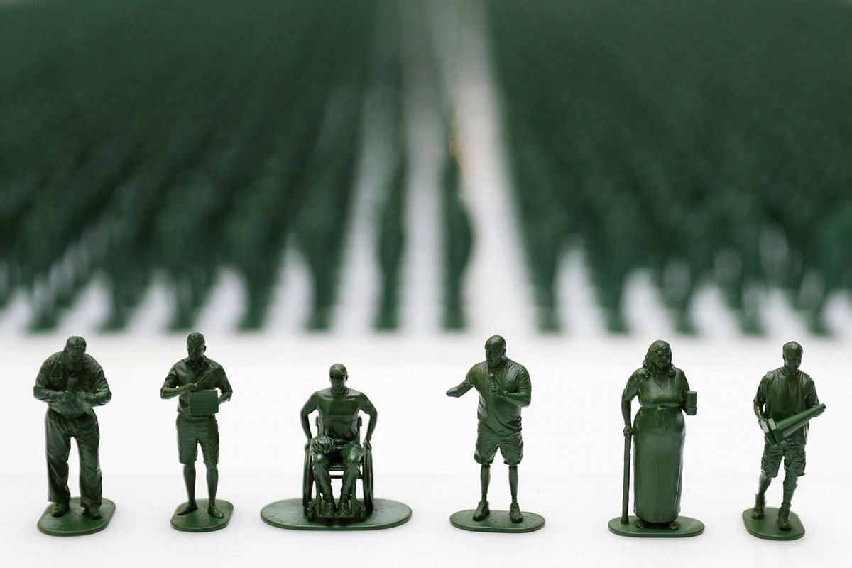 Three-dimensional printed plastic figures of seven medically discharged veterans are seen amongst 40,000 other figures on display as part of an installation by the charity Help for Heroes to highlight the number of veterans medically discharged from