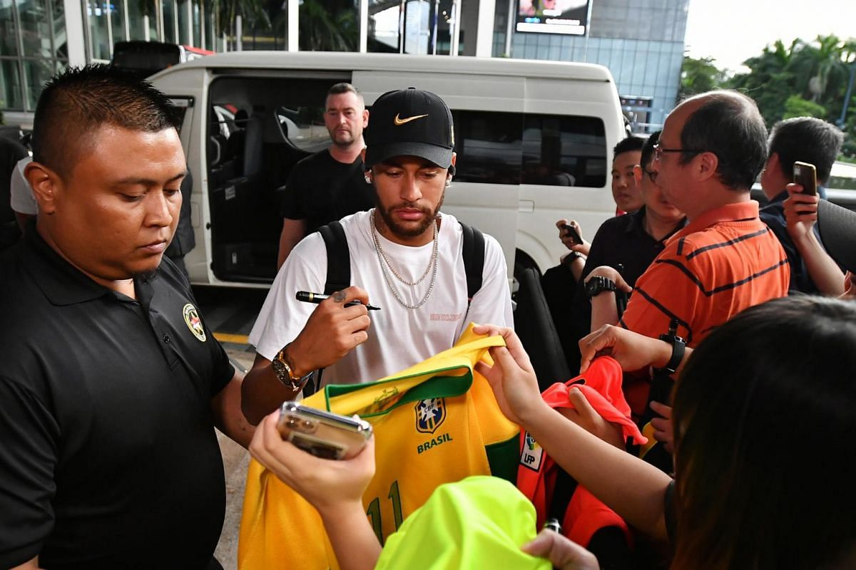 Brazil team player Neymar signs autographs for fans at the JW Marriott Hotel Singapore South Beach on Oct 7, 2019.