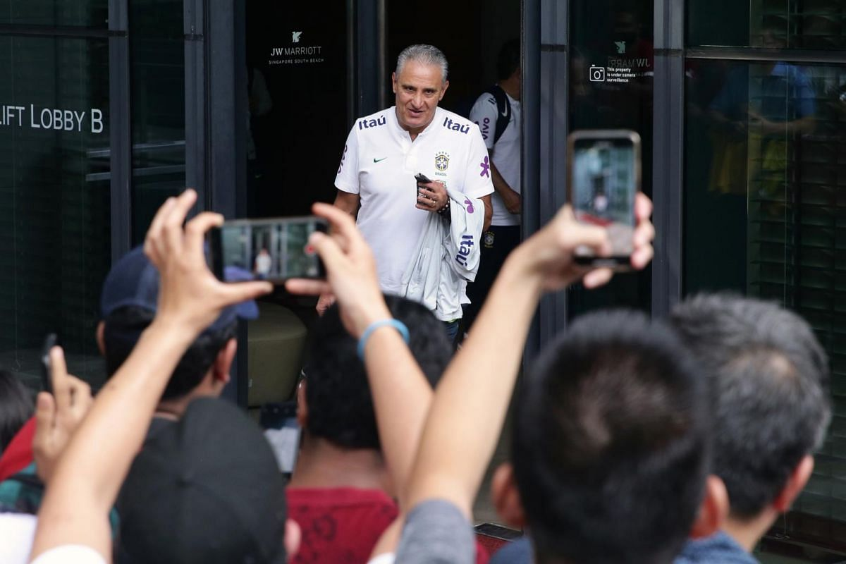Brazilian national team coach Tite departs JW Marriott Singapore South Beach for an evening training session on Oct 7, 2019.
