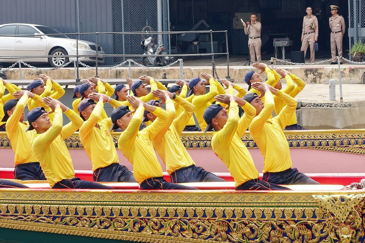 Oarsmen from the Royal Thai Navy paying their respects to the King after a rehearsal for the royal barge procession.