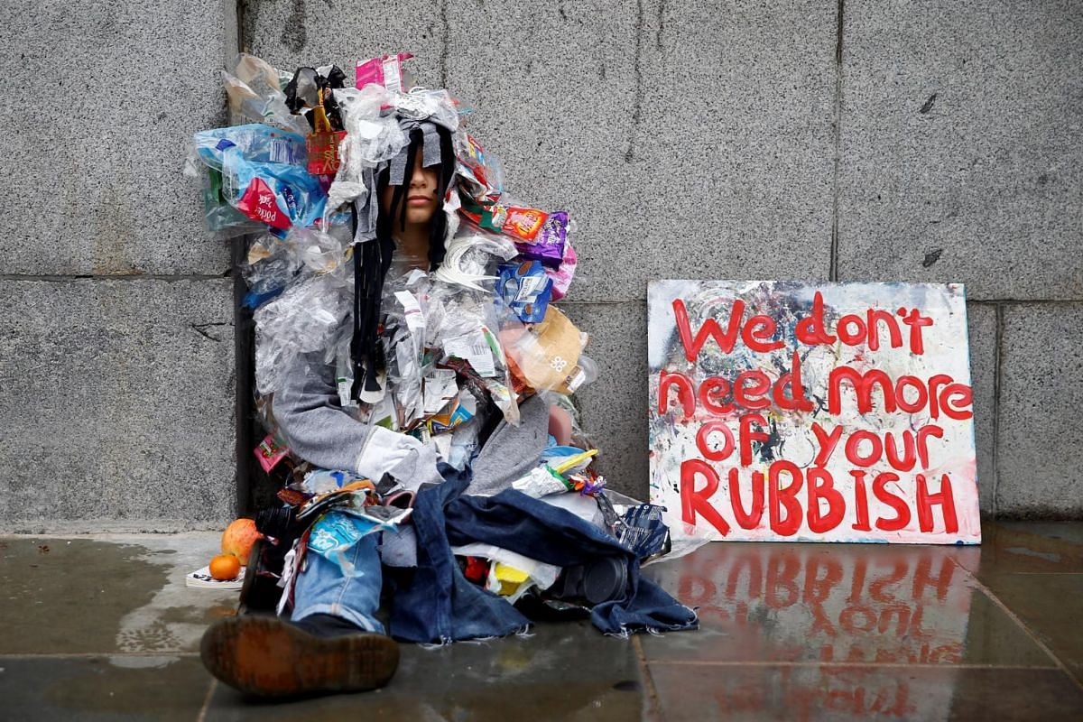Demonstrator wears an outfit made of rubbish sits outside the Houses of Parliament during the Extinction Rebellion protest in London, Britain, on Oct 7, 2019.