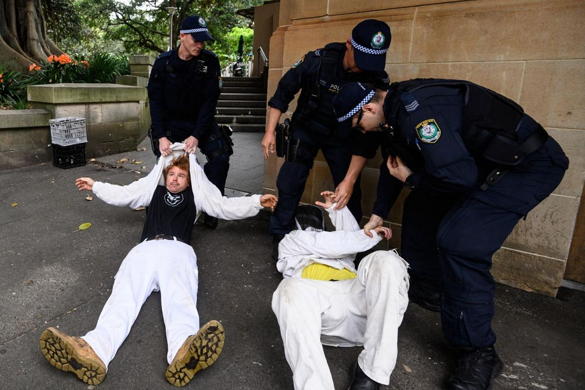 Police apprehend protesters during a protest organised by environmental movement Extinction Rebellion to draw attention to climate change.