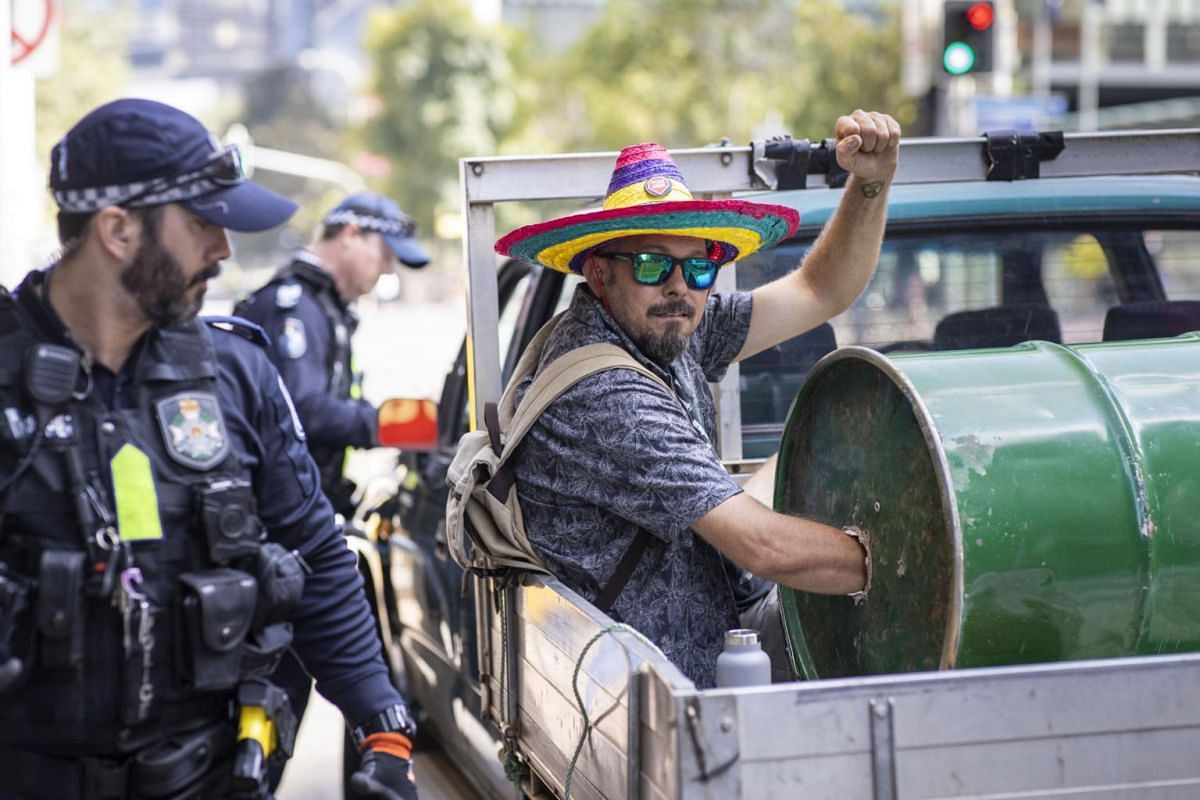 An activist from Extinction Rebellion with his arm in a barrel of cement participating in a protest on George Street, Brisbane, Queensland, Australia, on Oct 8, 2019.