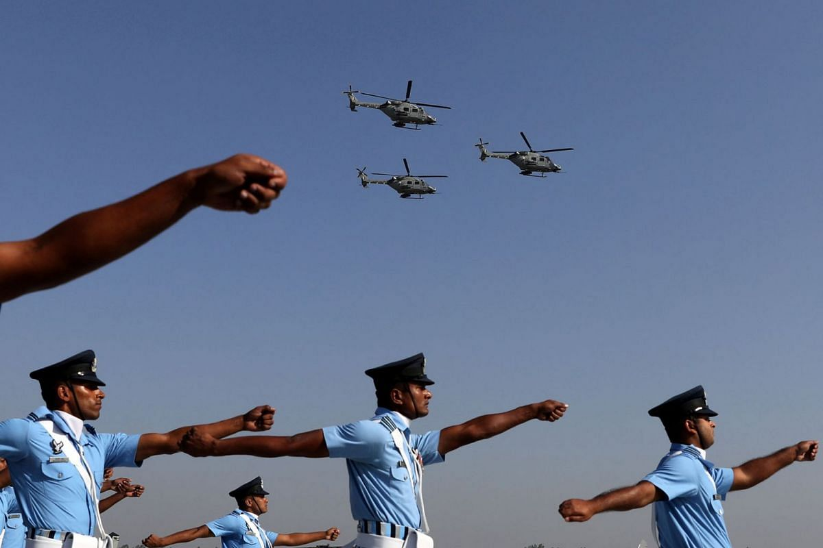Indian Air Force (IAF) soldiers march as advanced light helicopters fly during the Indian Air Force Day celebrations at the Hindon Air Force Station on the outskirts of New Delhi, India, October 8, 2019. PHOTO: REUTERS