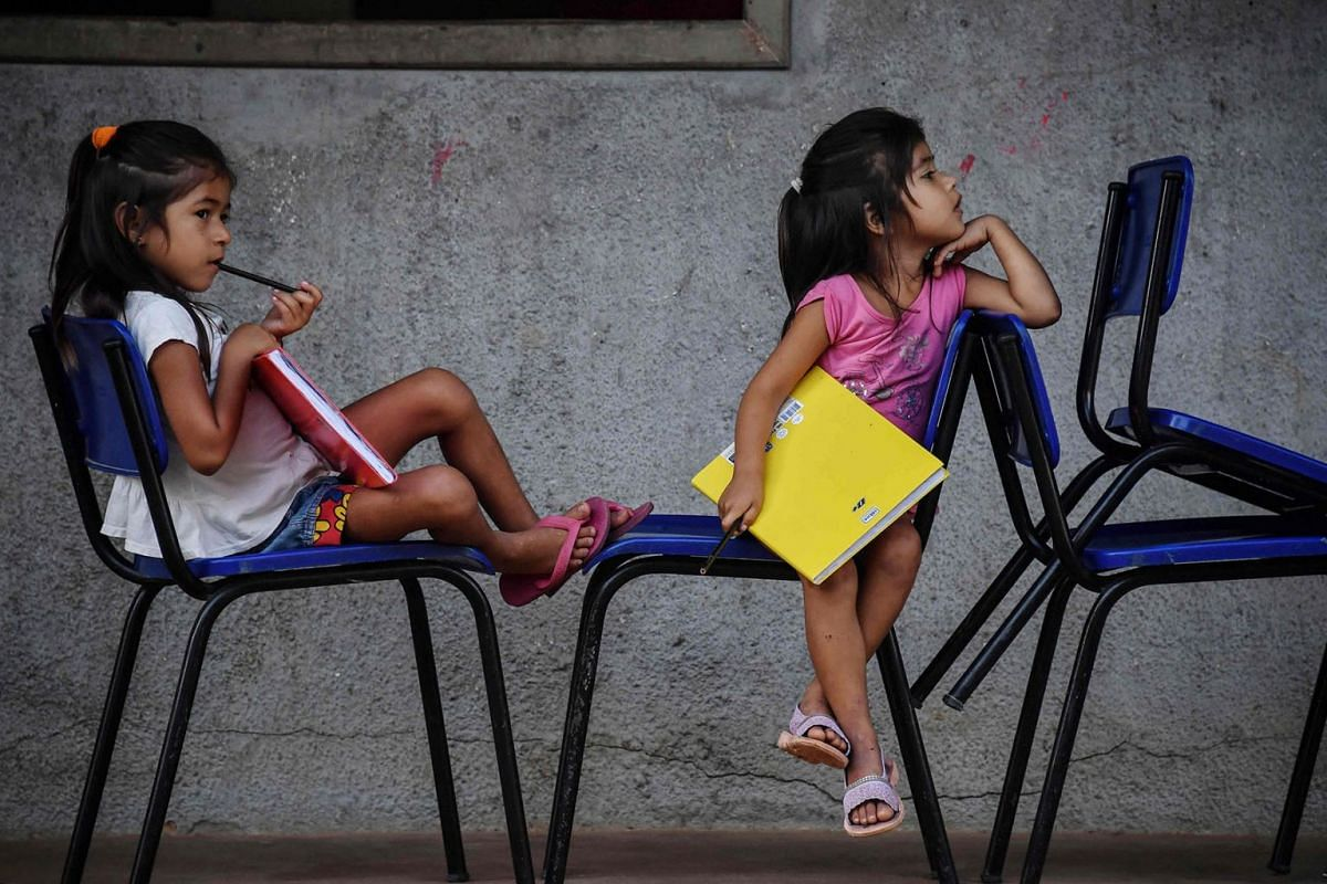 A photo issued on Oct 8, 2019 shows Munduruku indigenous girls waiting for a class at a school in Praia do Mangue indigenous reserve, in Itaituba, Para state, Brazil, in the Amazon rainforest, on September 10, 2019. PHOTO: AFP