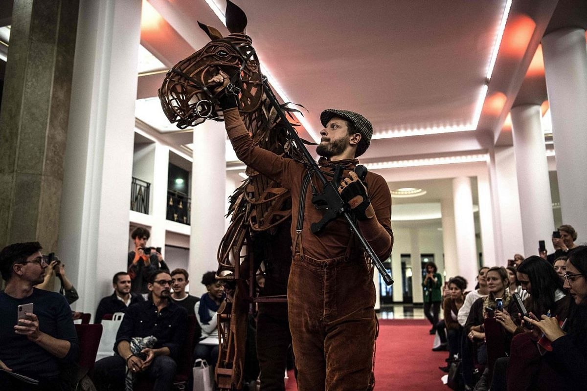 "A puppeteer handles Joey, a horse puppet and character of the ""War Horse"" show written by British author Michael Morpurgo, during a presentation at the Salle Pleyel in Paris on October 8, 2019. PHOTO: AFP"