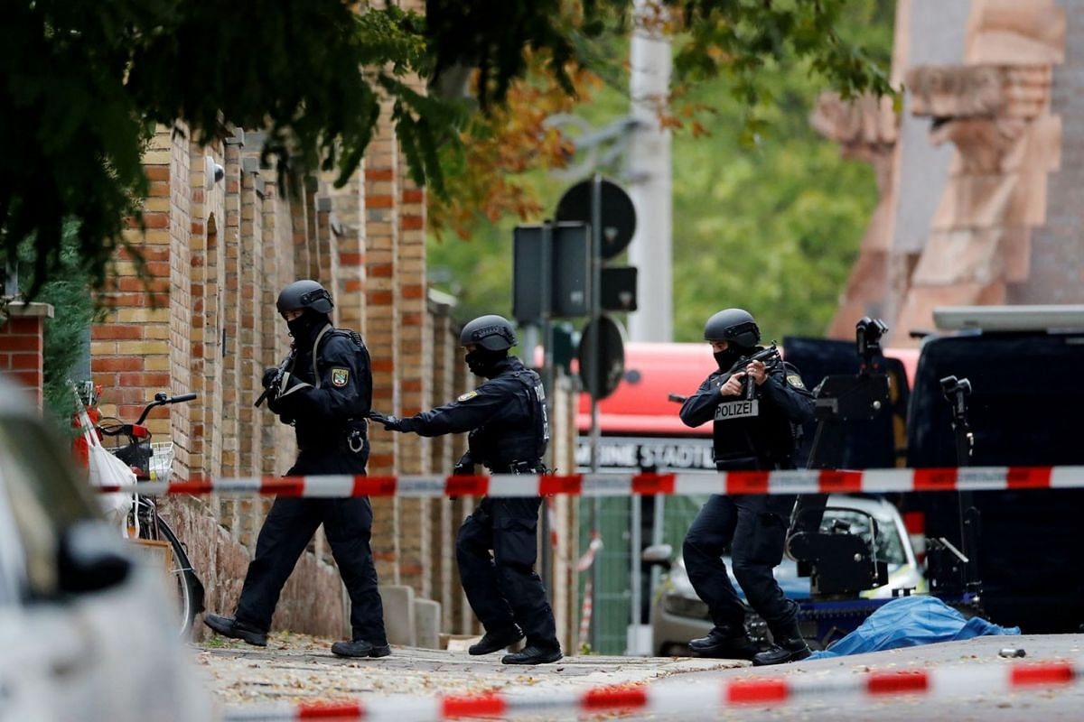 Police officers work at the site of a shooting, in which two people were killed, in Halle, Germany October 9, 2019. PHOTO: REUTERS