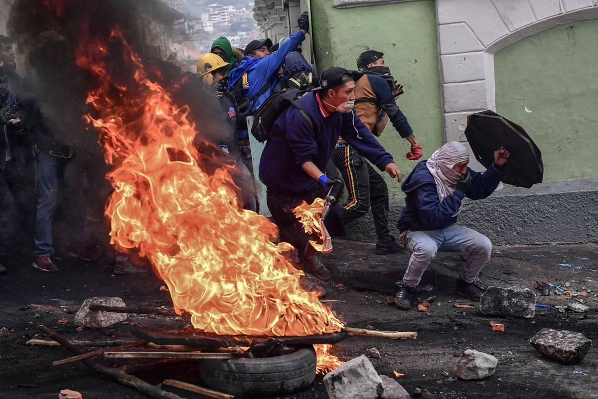 Demonstrators clash with riot police in Quito on October 9, 2019 on the second day of violent protests over a fuel price hike ordered by the government to secure an IMF loan. PHOTO: AFP