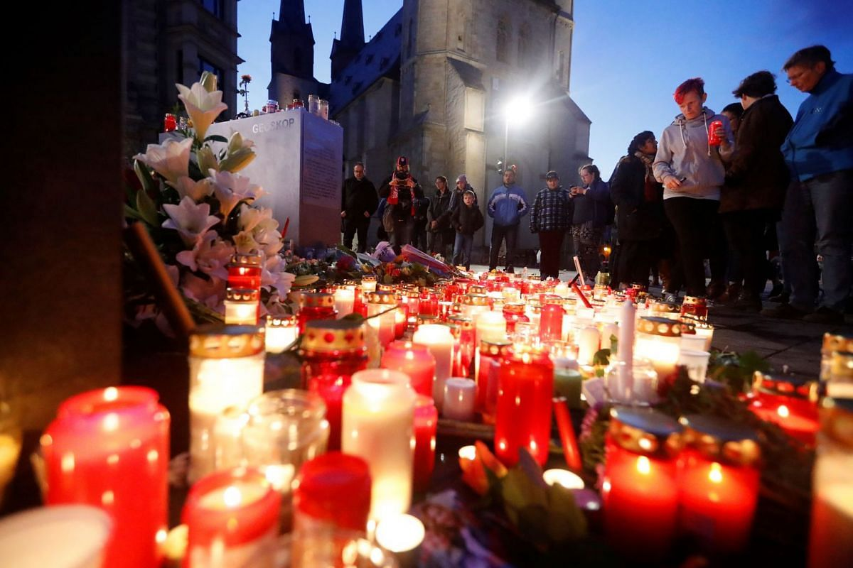 Mourners gather at the market square in Halle, Germany October 10, 2019, after two people were killed in a shooting. PHOTO: REUTERS
