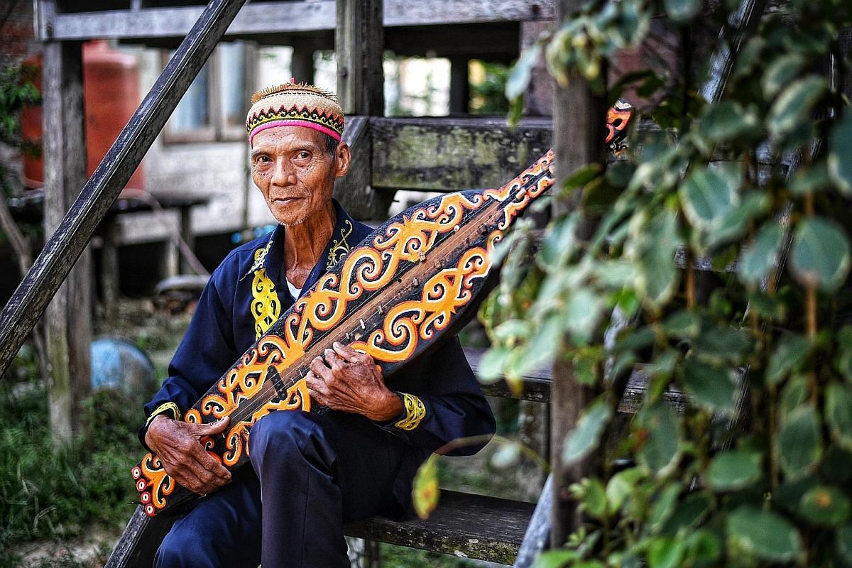 Mr Ujang Laing, 79, who moved to the city with his wife and two children in 1978, still plays the sampe, a traditional lute.