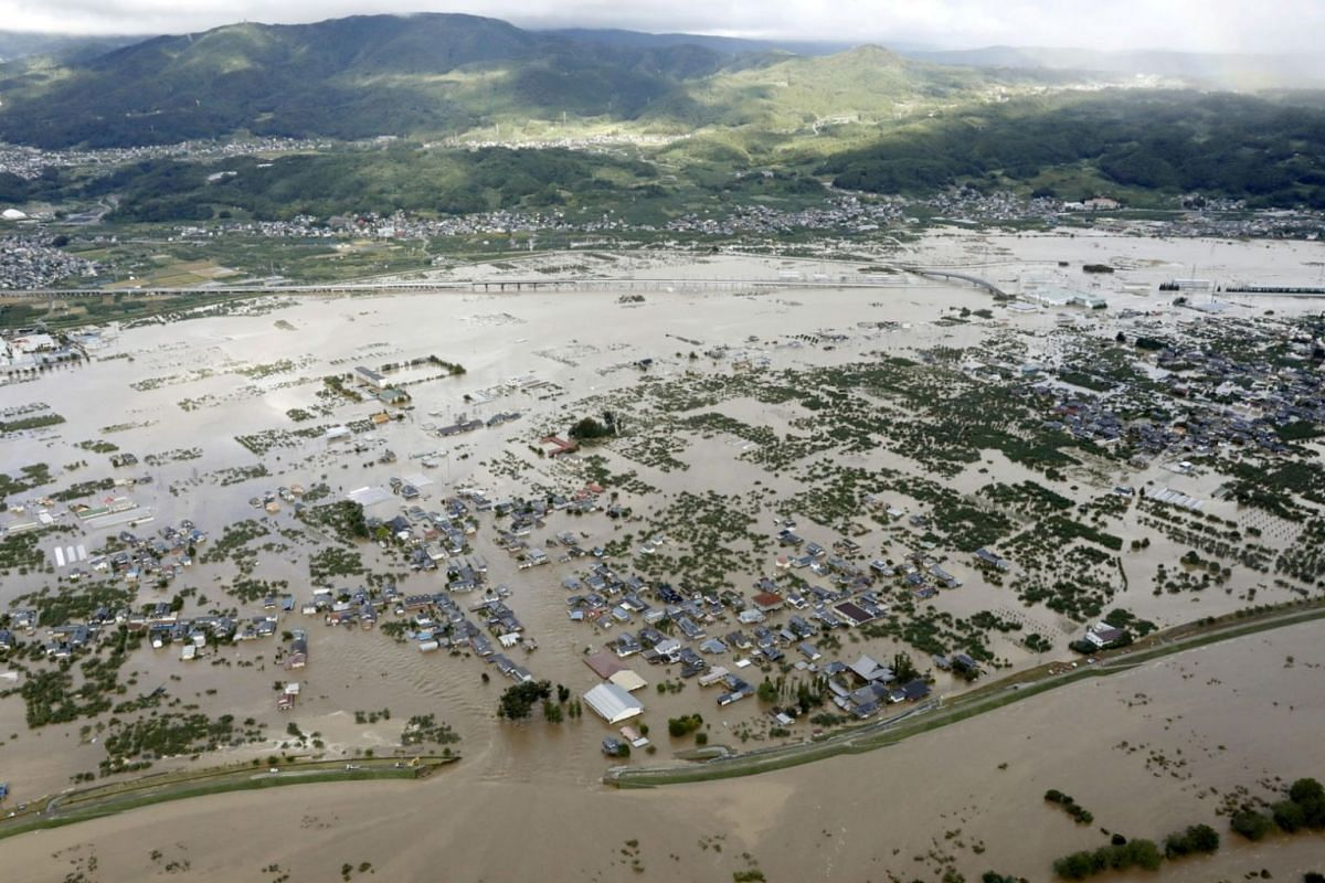Residential areas flooded by the Chikuma river as Typhoon Hagibis hits Nagano, on Oct 13, 2019.