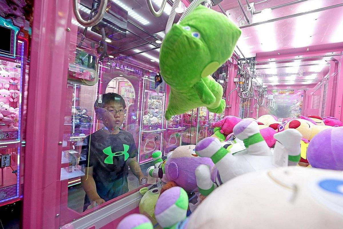 Primary 4 pupil Ewan Ong plays claw machines at least thrice a week and keeps more than 60 plushies, which he won, at home.