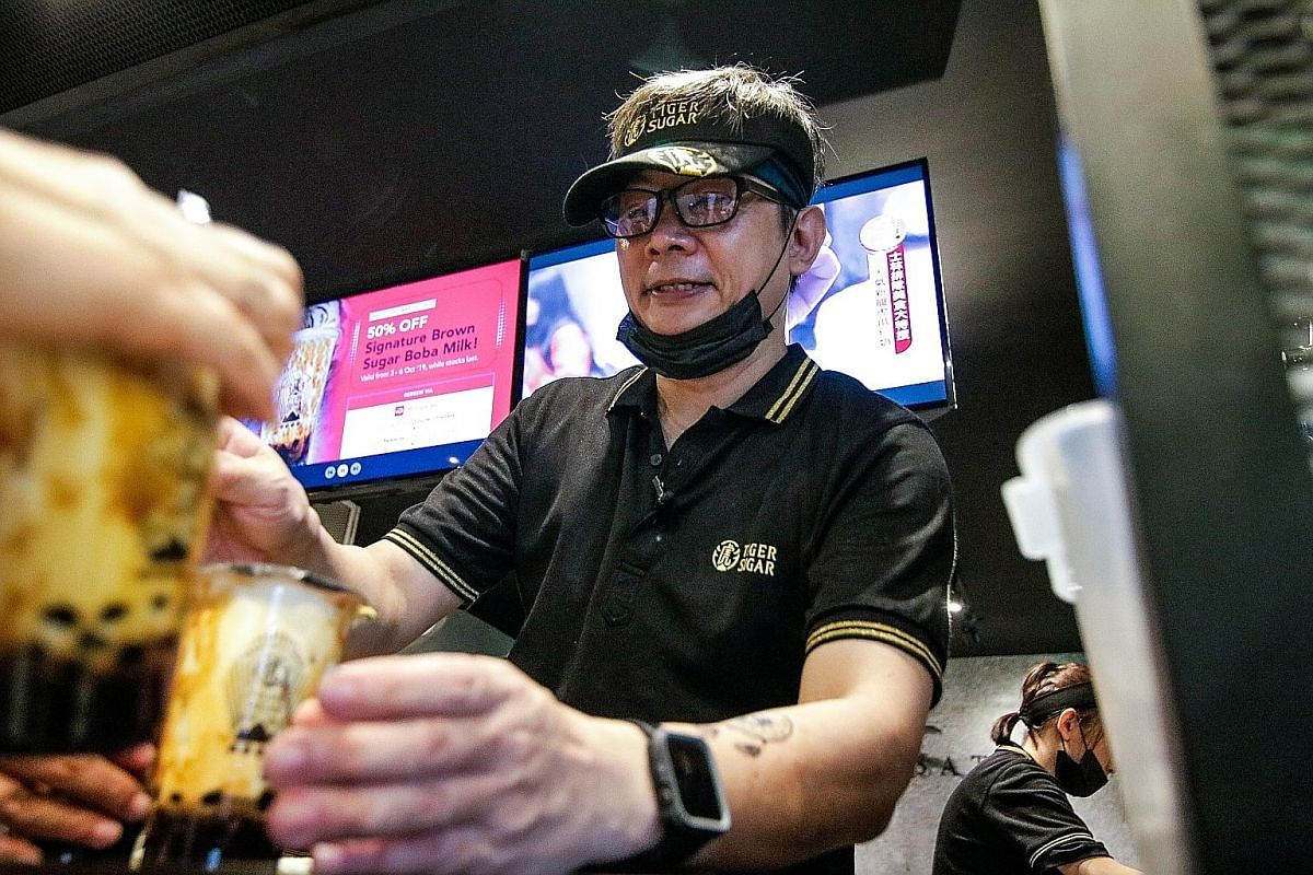 John Lui in charge of the pick-up counter at the Tiger Sugar bubble tea outlet in Paragon.
