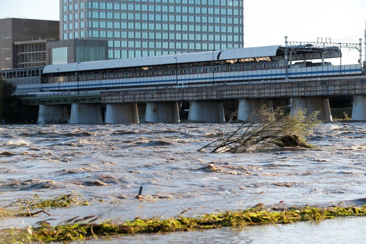 A view of Tama river in Tokyo which reaches flood risk level on Oct 12, 2019.