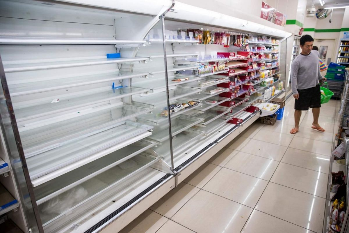 Empty shelves greet shoppers at a convenience store in Tokyo's Shinagawa district on Oct 12, 2019, as residents heed the weatherman's call to prepare for the worst.