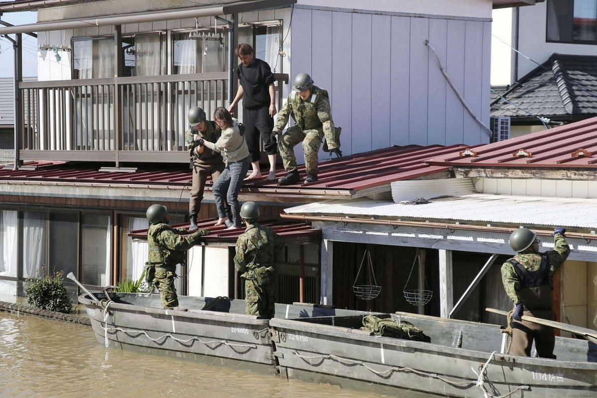 Local residents are rescued by Japapnese Defence-Force soldiers from a flooded area caused by Typhoon Hagibis in Kakuda, Miyagi prefecture, Japan, October 13, 2019, in this photo taken by Kyodo. PHOTO: HANDOUT VIA REUTERS