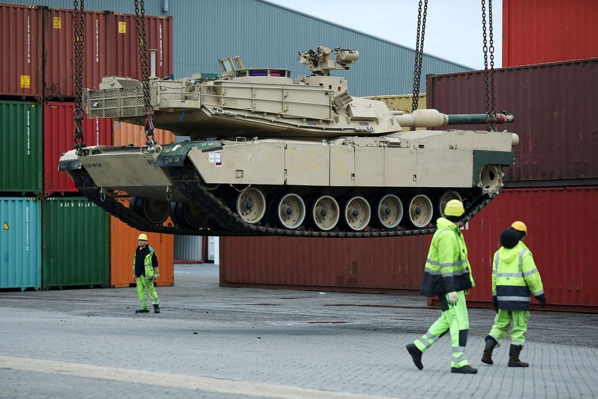 Tanks and support vehicles are transported at the military port in Vlissingen, Netherlands October 14, 2019. PHOTO: REUTERS
