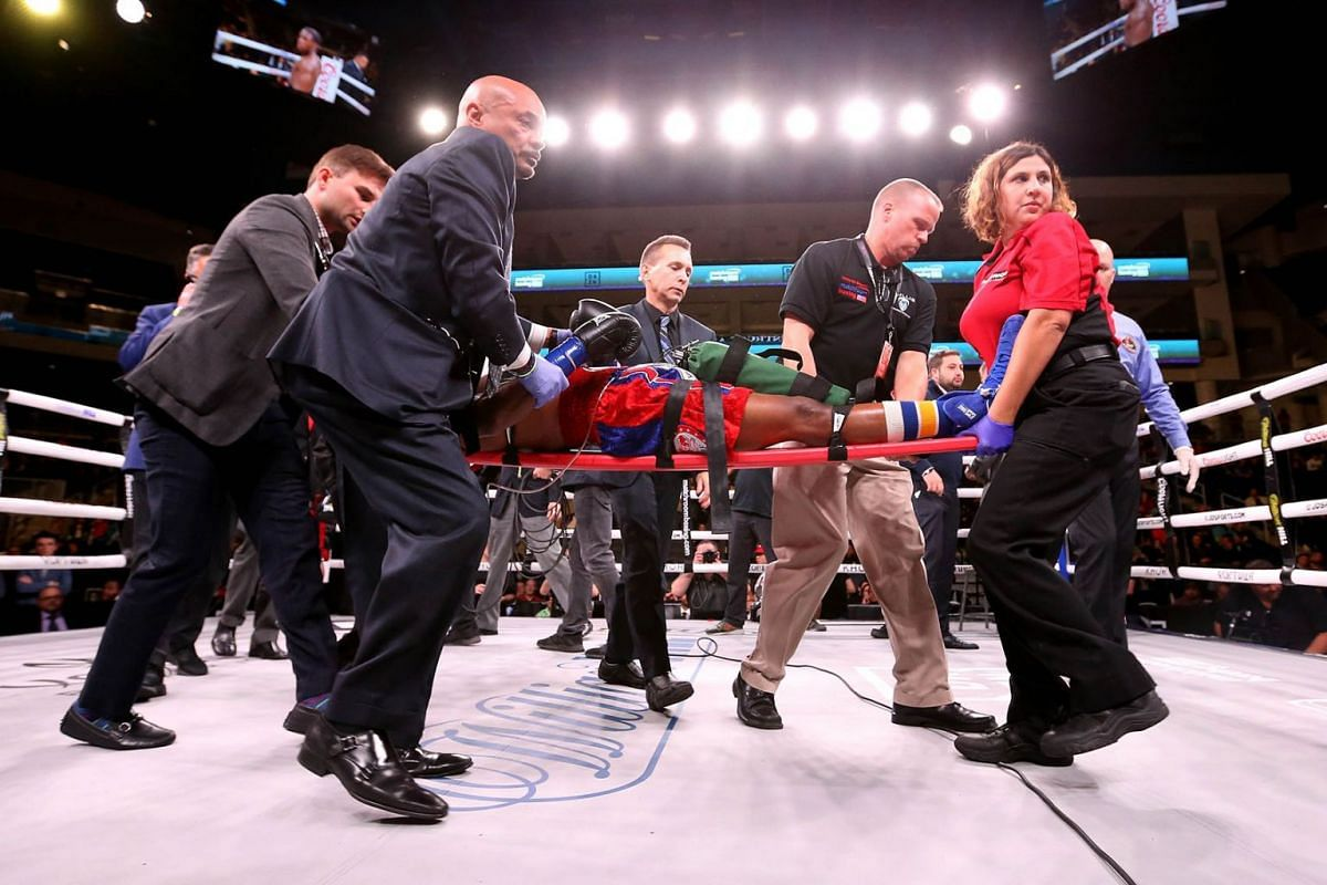 Patrick Day is taken out of the ring after being knocked out in his Super-Welterweight bout against Charles Conwell at Wintrust Arena on October 12, 2019 in Chicago, Illinois. PHOTO: GETTY IMAGES/AFP