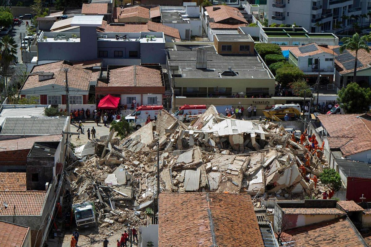 Firefighters search among the debris of the seven-floor residential building collapsed earlier today in Fortaleza, Ceara state, northeast of Brazil, on October 15, 2019. PHOTO: AFP