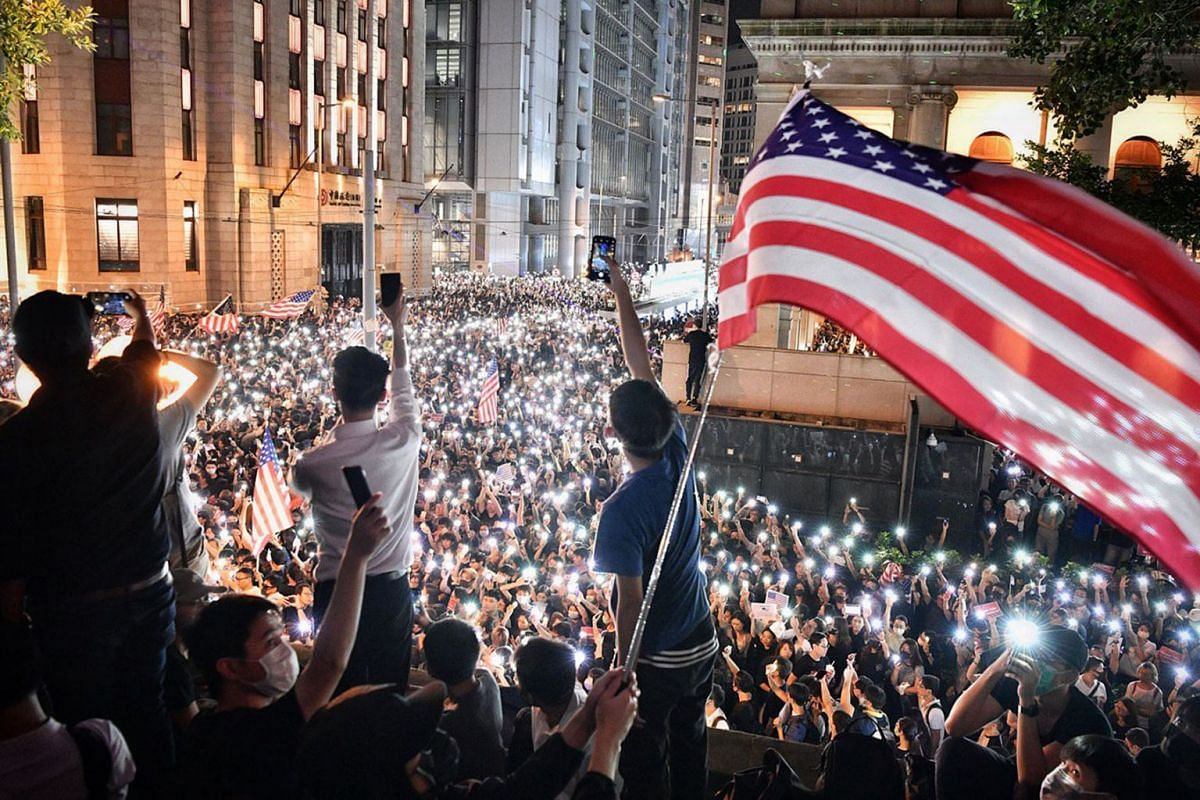 Protesters in Hong Kong flying the American flag in Chater Garden near government headquarters on Oct 14, 2019. It was the first approved rally since a face mask ban came into effect on Oct 5. PHOTO: THE STRAITS TIMES/CHONG JUN LIANG