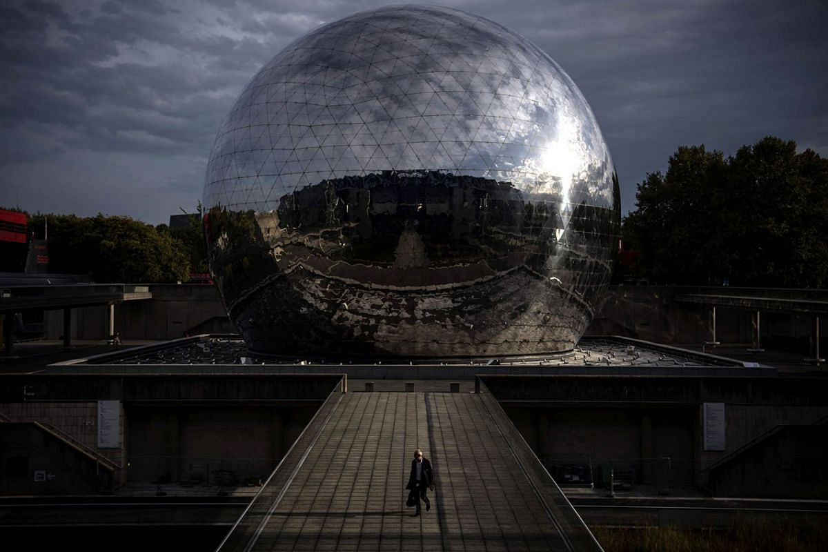 A man walks past the 'Geode', a steel sphere housing a screening room at the Cite des Sciences et de l'Industrie ( City of Science and Industry), on October 14, 2019 in Paris. PHOTO: AFP