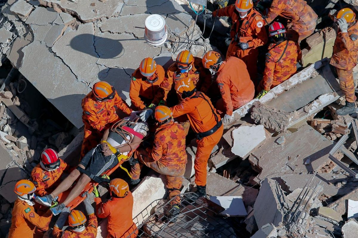 Firefighters rescue a survivor from the remains of a seven-storey residential building that collapsed in Fortaleza, north-eastern Brazil, on Oct 15, 2019.