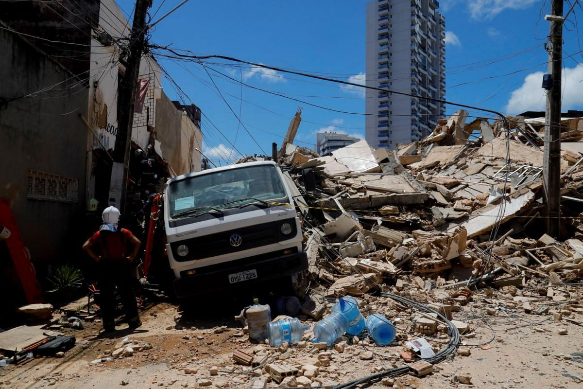A rescue worker surveys the remains of a seven-storey residential building after it collapsed, in Fortaleza, Brazil, on Oct 15, 2019.
