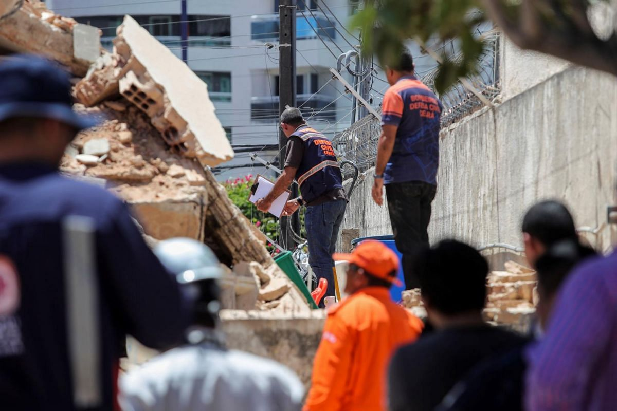 Rescuers and firefighters work at the site where a seven-storey residential building fell, in Fortaleza, Brazil, on Oct 15, 2019.