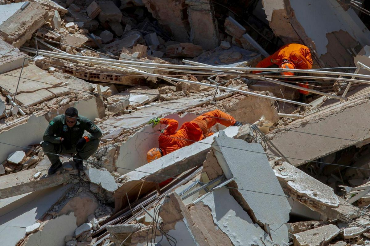 Firefighters search for survivors among the rubble after a seven-floor residential building collapsed in Fortaleza, Brazil, on Oct 15, 2019.