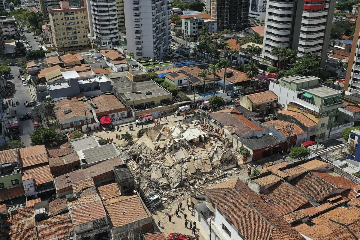 Firemen and rescue personnel work to clear debris where a seven-storey residential building collapsed in Fortaleza, Brazil, on Oct 15, 2019.