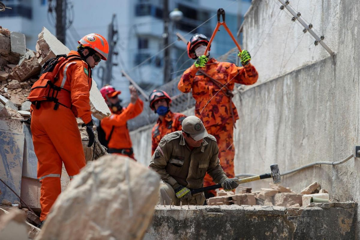 Rescuers and firefighters work at the site where a seven-storey residential building collapsed, in Fortaleza, Brazil, on Oct 15, 2019.