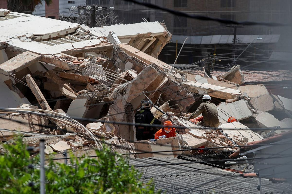 Rescue personnel dig through rubble after the collapse of a seven-storey residential building, in Fortaleza, Brazil, on Oct 15, 2019.