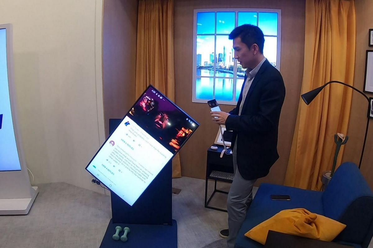 Mr Junsung Chung of Samsung's Home Internet of Things Business team shows a television set that can be connected to a phone and rotated to mirror its display screen at a smart home studio in the Digital City.