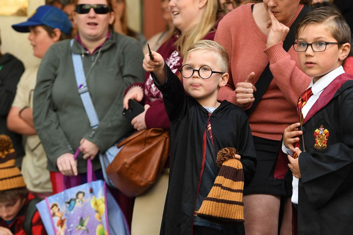 Harry Potter fans gather outside the Harry Potter Concept store in Melbourne, Australia, October 18, 2019. Warner Brothers has teamed up with Myer to unveil the country's largest Harry Potter concept shop. PHOTO: EPA-EFE