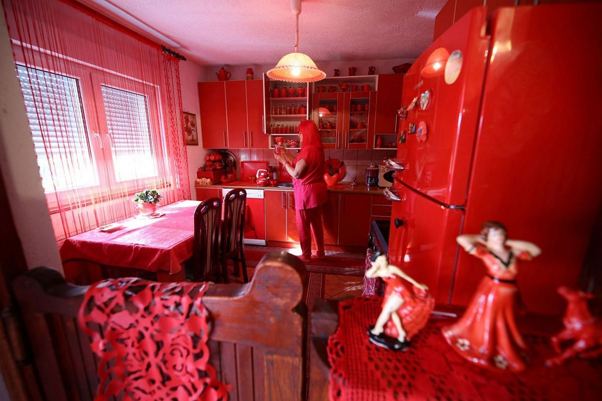 Zorica Rebernik, obsessed with the color red, stands in the kitchen inside her house in the village of Breze near Tuzla, Bosnia and Herzegovina October 16, 2019. PHOTO: REUTERS