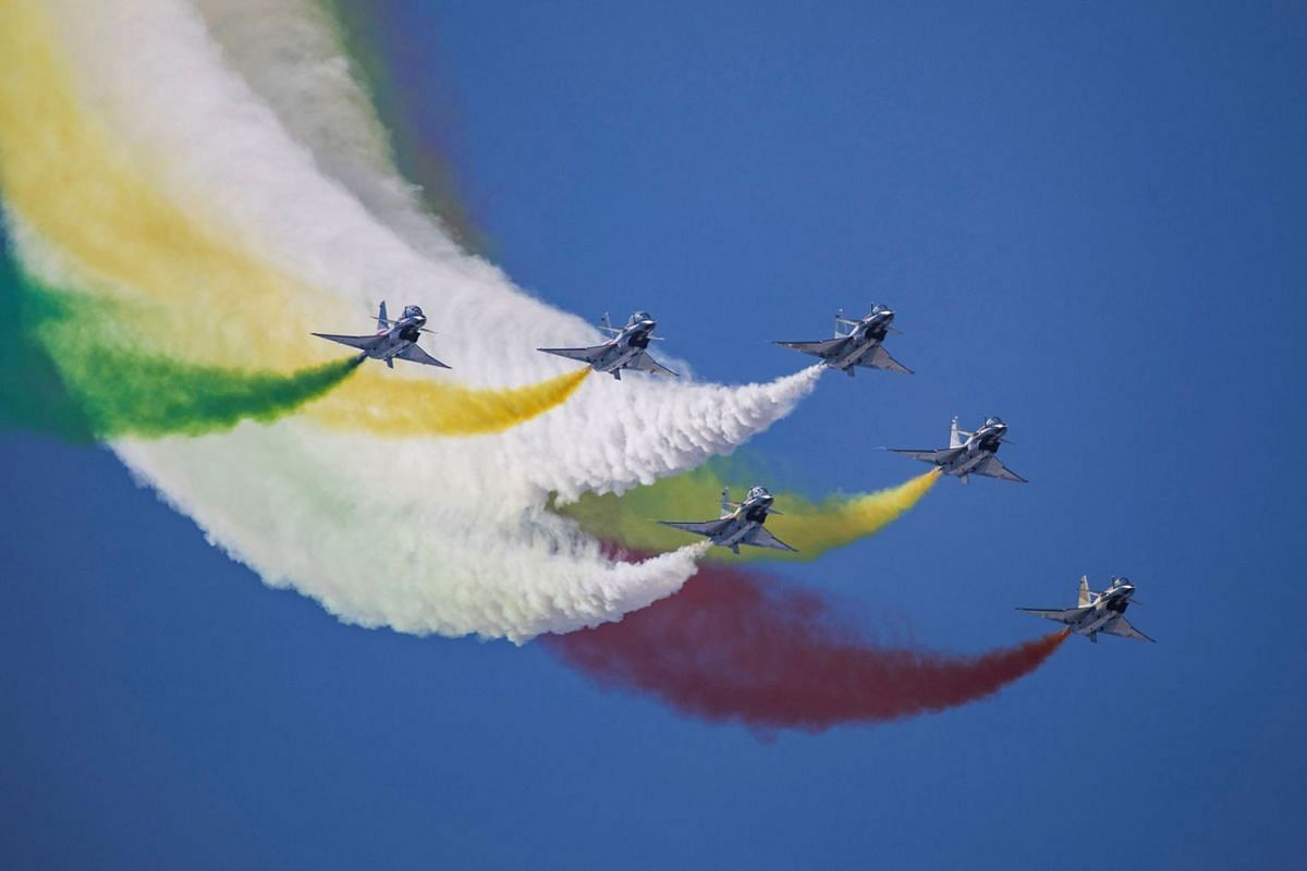 This photo taken on October 17, 2019 shows China's Bayi Aerobatic Team performing in the sky during the Chinese People's Liberation Army Air Force Aviation Open Day in Changchun in China's northeastern Jilin province, to mark the 70th anniversary of