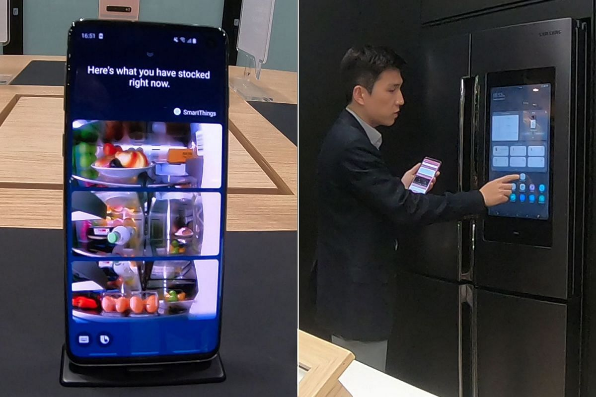 Mr Junsung Chung presenting a Samsung smart fridge at a smart home studio in the Digital City. Contents of the fridge can be accessed via a mobile device, making it more convenient for consumers to decide what they need to buy from outside their home