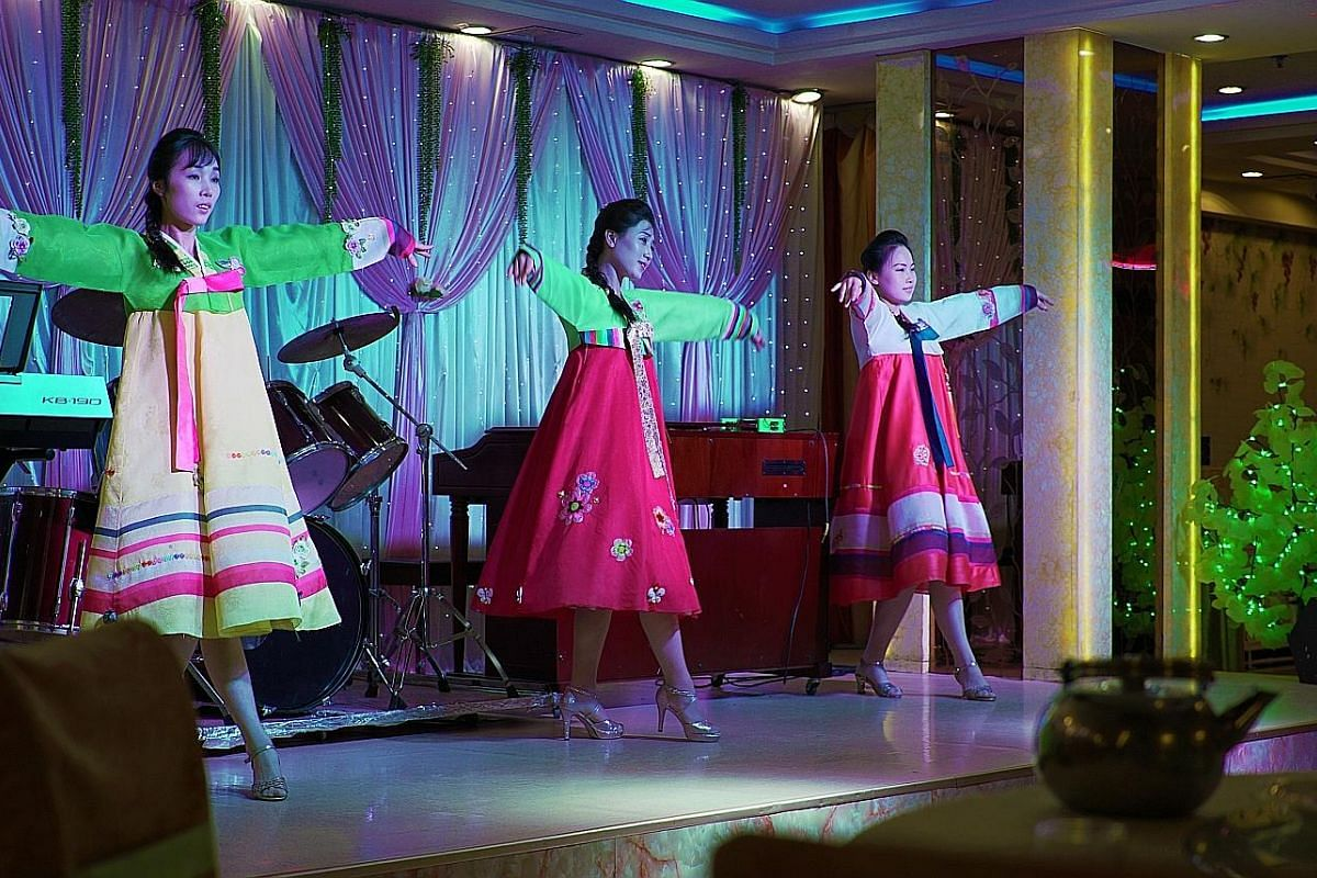 At Pyongyang Restaurant in Shenyang, North Korean waitresses double as performers.