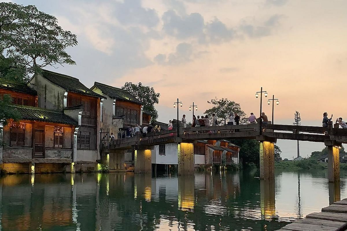 Step into Old China in Wuzhen, with its arched stone bridges and intricate canal systems.