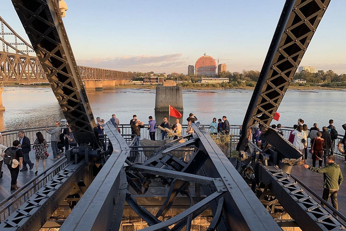 The Yalu River Broken Bridge in Dandong, bombed out during the US-Korean War, has been converted into a tourist destination.