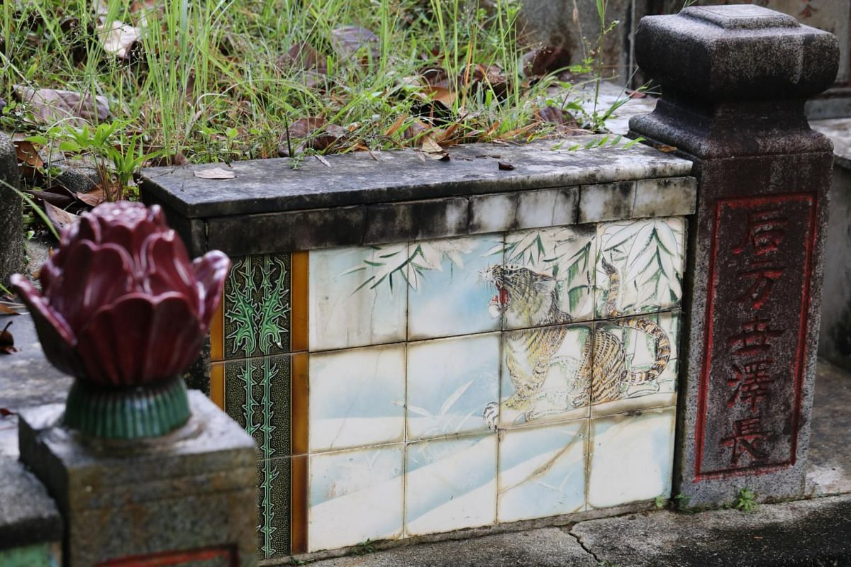 """""""Tiger tomb"""". An elegant mix of Western and Eastern inspiration features in this 1939 twin tomb with two large tile panels depicting a tiger at rest under snow-laden bamboo trees."""