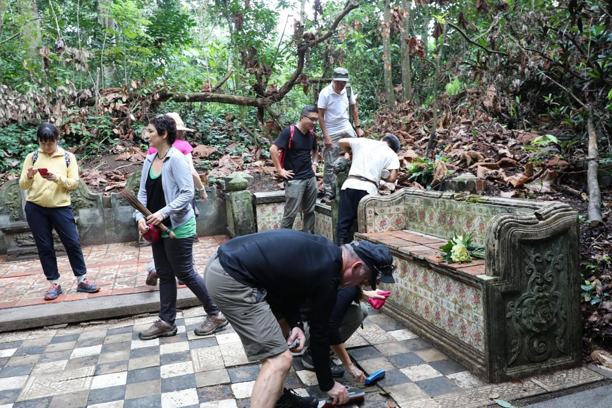 """""""The Bench"""". Volunteers revisit and tidy up a tomb with a tiled bench that had been previously cleared during an earlier session, taken on Oct 4, 2019."""