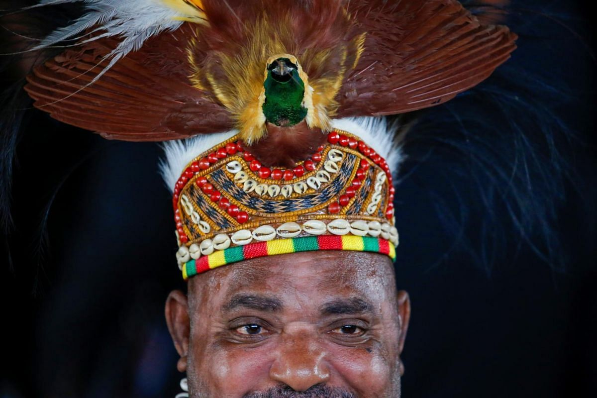 An Indonesian Parliament member wearing a traditional hat from Papua arrives to attend the inauguration of President Joko Widodo for a second term, in Jakarta, Indonesia, Oct 20, 2019.